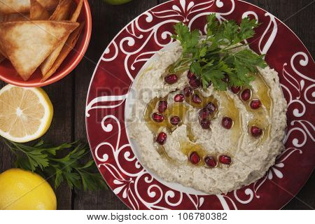 Baba ghanoush, levantine eggplant dip with pomegranate and olive oil