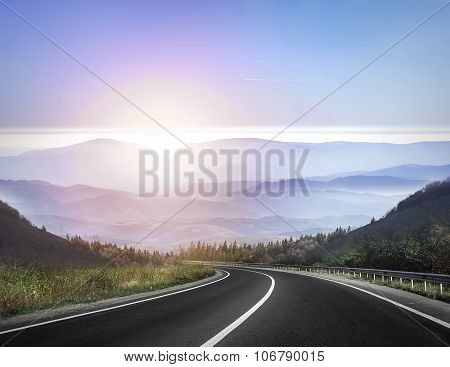 Highway against mountains.