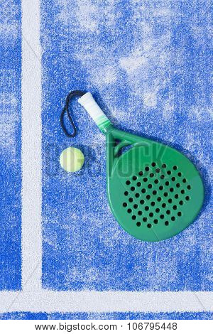 Racket And Ball Of Paddle Tennis Background