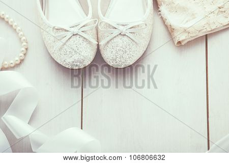 Christmas background: silver glitter shoes and gold dress, holiday decoration, top view