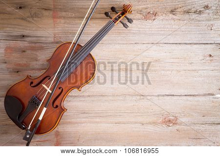 Violin Instrument On Wooden Floor With Copy Space
