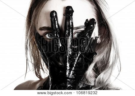 Woman Holding A Tarred Hand On Her Face