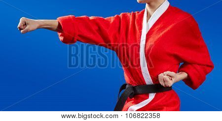 Sportswoman dressed as Santa Claus hits a punch hand