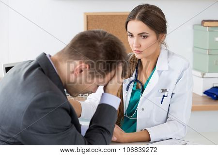 Friendly Female Medicine Doctor's Holding Male Patient's Hand Supporting Him