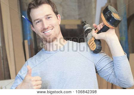 A carpenter working hard at the workshop