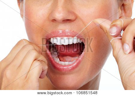 Woman teeth with dental floss. Dentistry health care.