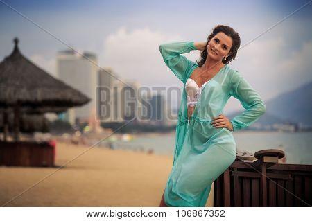 Closeup Girl In Underwear Leans On Barrier At Beach Umbrellas