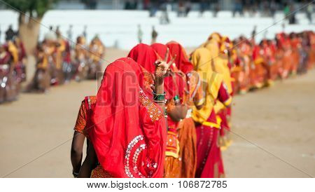 Indian girls in colorful ethnic attire dancing at Pushkar fair Pushkar Rajasthan India Asia poster