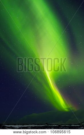 Beautiful green Northern light in the starry sky, natural phenomenon, Aurora Australis, wonderful nature of Iceland