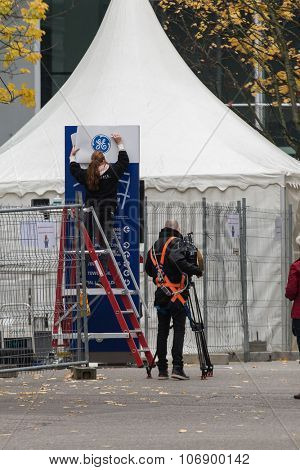 BADEN, SWITZERLAND. November 2nd, 2015. Alstom logos being removed by worker to install GE logos for merger and acquisition of General Electric.