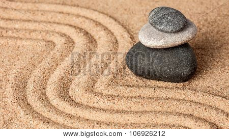 Japanese Zen stone garden - relaxation, meditation, simplicity and balance concept  - panorama of pebbles and raked sand tranquil calm scene