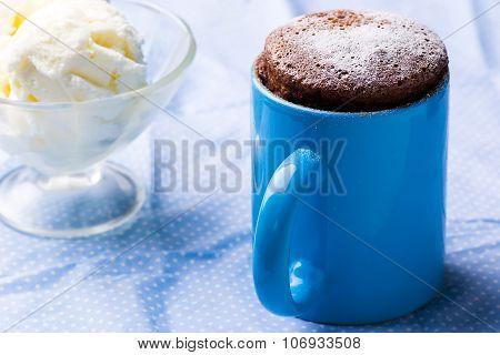 chocolate mug cake prepared in microwave . horizontal permission. selective focus poster