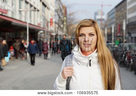 woman walking pedestrian street