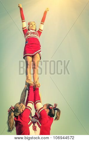 Cheerleaders In Action On A Vintage Filtered Look - Concept Of Unity And Team Sport