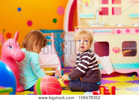Cute Little Kids Playing Together In Daycare Center