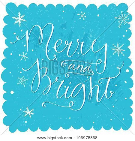 Merry and bright. Christmas lettering at blue snow background, holiday card with calligraphy