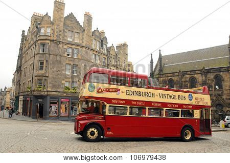 a vintage double decker tour bus