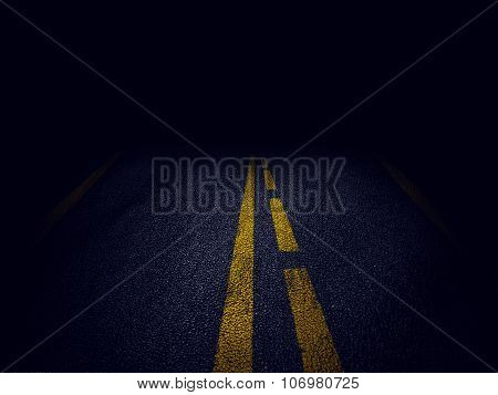 yellow stripes in a road at night