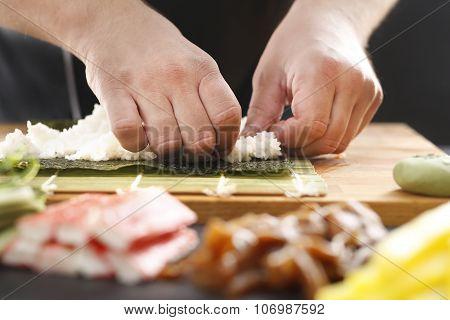 Sushi master preparing sushi in Japanese restaurant poster