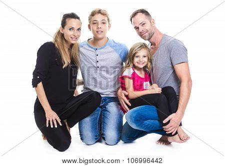 beautiful family on studio white background