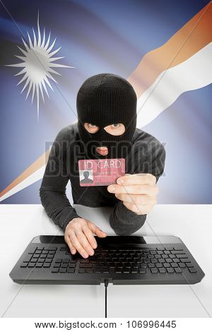 Hacker With Flag On Background Holding Id Card In Hand - Marshall Islands