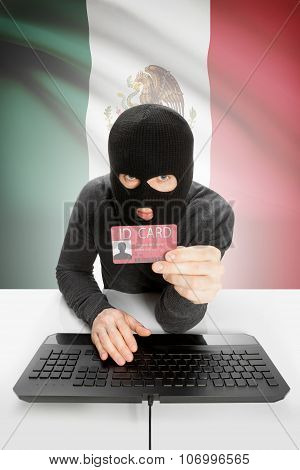 Hacker With Flag On Background Holding Id Card In Hand - Mexico