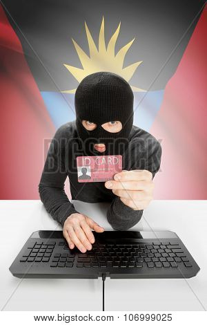 Hacker with ID card in hand and flag on background - Antigua and Barbuda poster