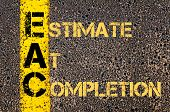 Concept image of Business Acronym EAC as ESTIMATE AT COMPLETION written over road marking yellow paint line. poster