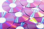 Group of DVDs on a white background poster