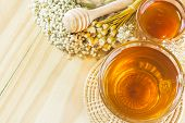 tea with honey on wood backgroundwarm toning selective focus poster
