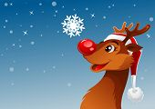 Young reindeer was looking at beautiful snowflake poster