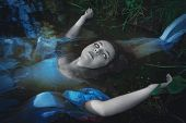 Terrible dead ghost woman lying in the water poster