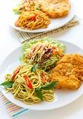 Italian Thai Fusion food Thai green curry spaghetti with fried chicken. poster