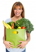 Woman with grocery bag of vegetables isilated white background. poster