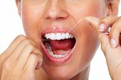 Woman teeth with dental floss. Dentistry health care. poster