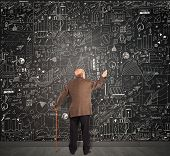 Genius business senior write on the blackboard poster