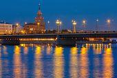 Latvian Academy of Sciences, Stone Bridge and River Daugava at night, Riga, Latvia poster
