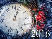 Christmas Eve and New Years at midnight. Clock covered with snow. 2016 new year. poster
