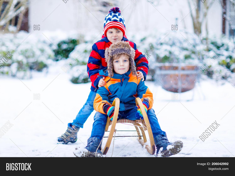 Christmas Vacation Sled.Two Kid Boys Enjoying Image Photo Free Trial Bigstock