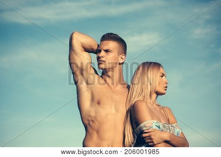 Man And Woman Posing On Blue Sky
