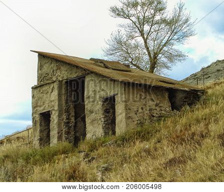 Old stone building in Ust-Kamenogorsk. Old fortification. Historic architecture. Historical place. Old historic building. Historic landscape. Stone style.
