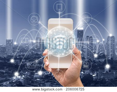 holding smart phone showing the mobile payments and online shopping with moni channel over the cityscape backgroundbusiness omni channel or multi Channel concept, 3D illustration