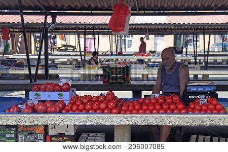 Man Is Selling Tomatoes At Street Market In Novi Sad