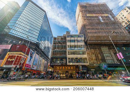 HONGKONG CHINA - July 12 : Many Undefiend people are walking on mongkok street for shopping on the July 12 2017 in Mongkok Hong kong