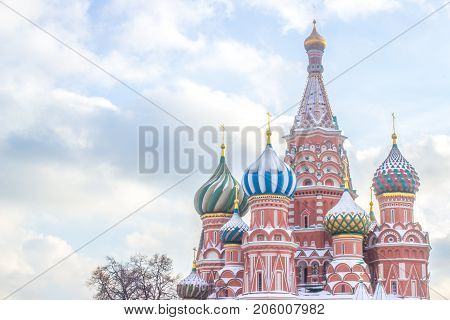 Landscape focus of Saint Basil Cathedral it's attraction traveler and the most popular landmark on Red square in Moscow, closeup of the roofs of St. Basil's Cathedral covered in snow at Russia, Beautiful View of colorful church on right of photo with whit