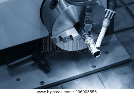 The automatic laser welding machine in light blue scene.