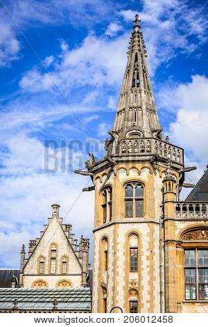 Gent city Belgium detail with Graslei district and Guildenhuis tower day sunlight with white clouds in Flanders