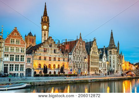Gent Belgium with Graslei district and Leie river at twilight illuminated moment in Flanders.