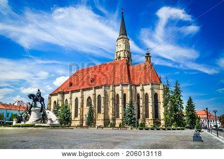 Cluj Romania. Medieval St. Michael's Church and Union Square in Cluj-Napoca Transylvania.