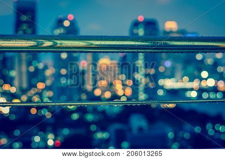 cityscape blurred photo with rains at twilight time